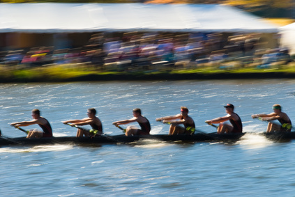 Rowing team working together